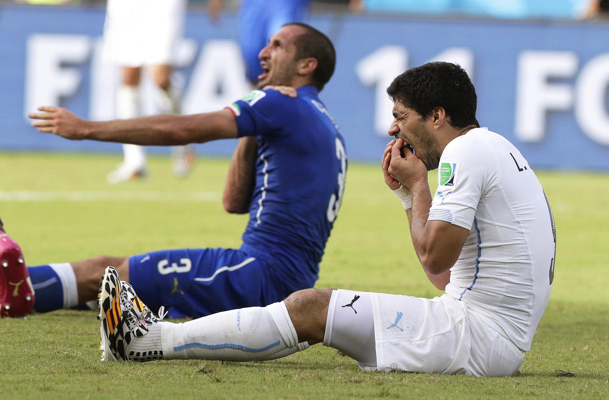 Luis Suarez bites opponent
